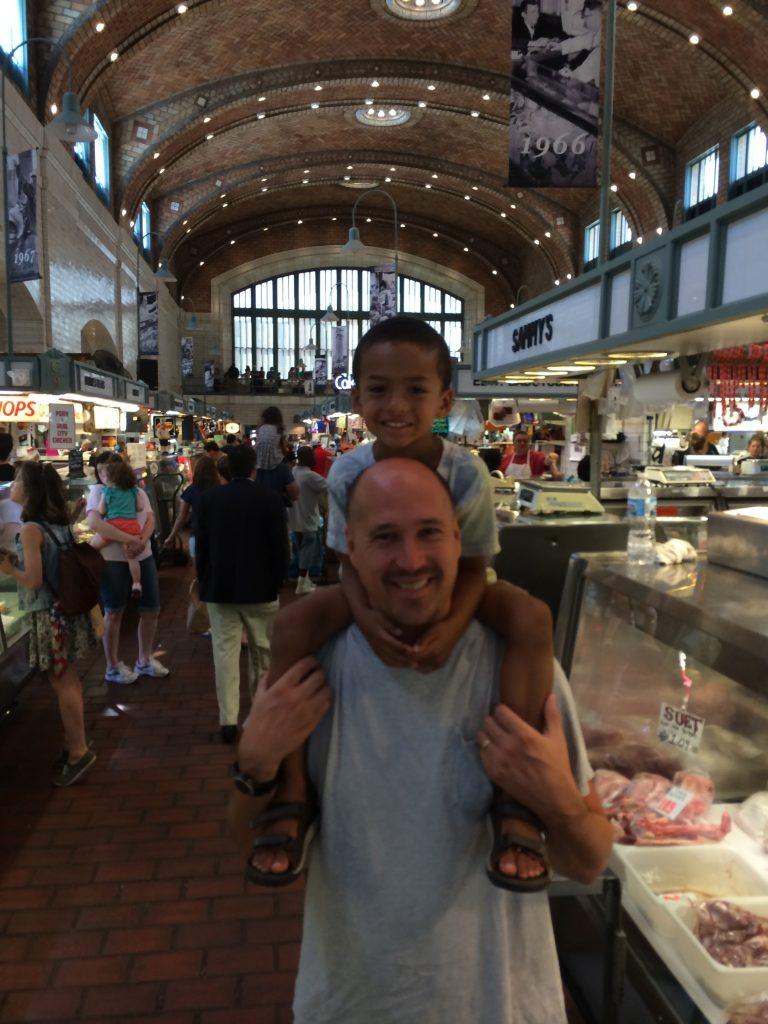 ©ClarendonMoms/Angelica Talan. Logan & Dave inside Cleveland's West Side Market.