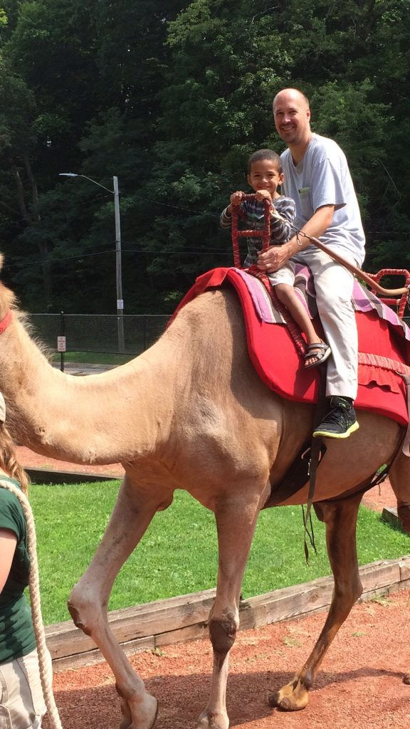 ©ClarendonMoms/Angelica Talan. Dave & Logan enjoy a $5 Camel Ride at the Cleveland Metroparks Zoo.