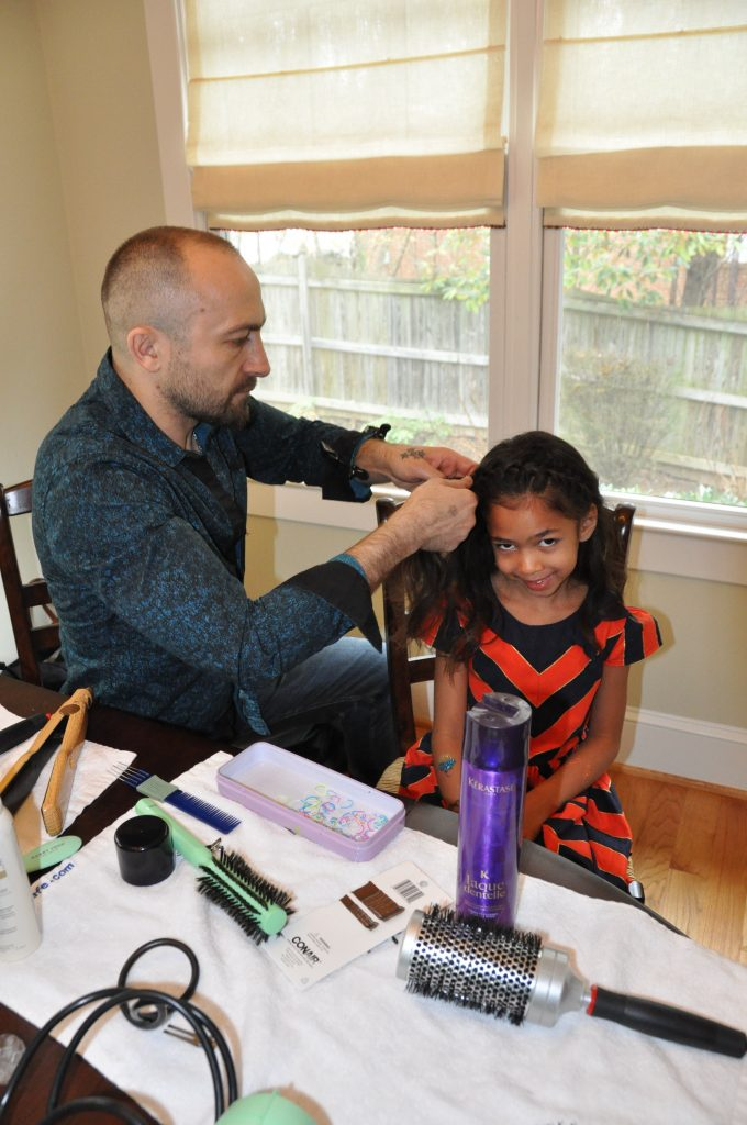 My daughter Ella getting her hair braided. Photo by ©Clarendon Moms