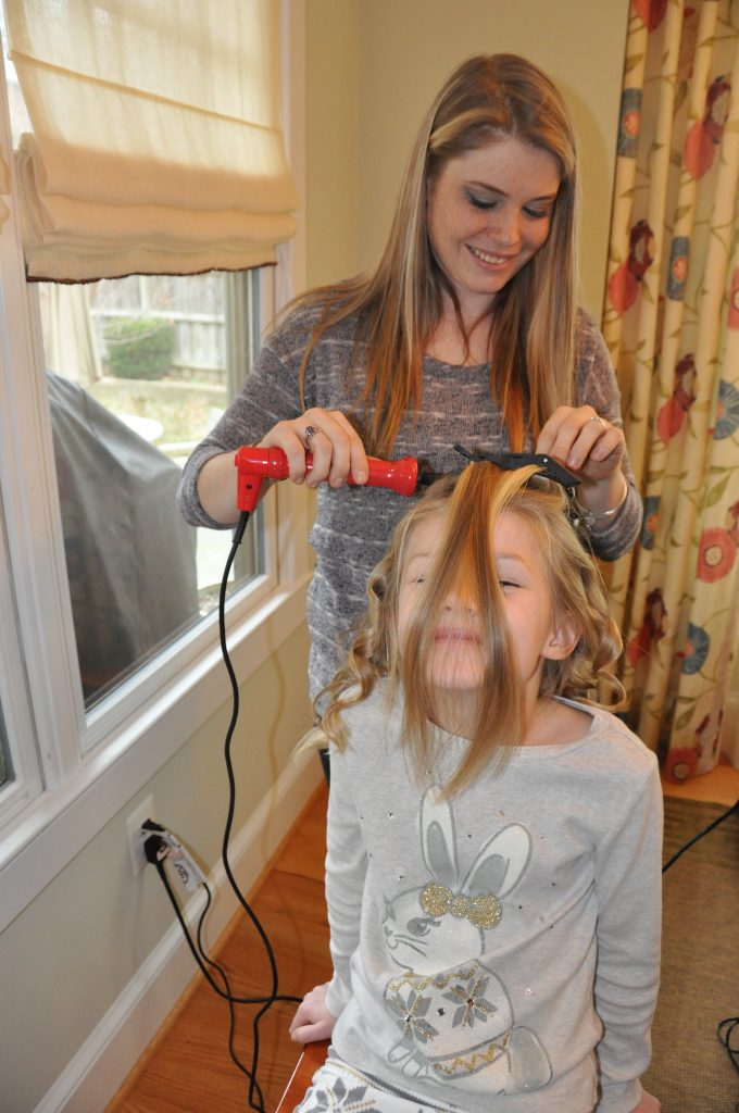 Bella getting cascade curls. Photo by © Clarendon Moms